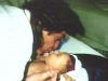 dc_kissing_newborn_beau