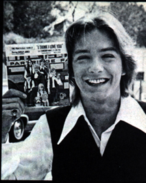 "1970. David holds the single ""I Think I Love You"""